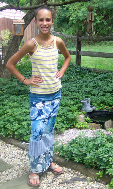 Here is a maxi tiered skirt that was sewn by adding differed tiers of cotton fabric onto a cut off old pair of jeans.