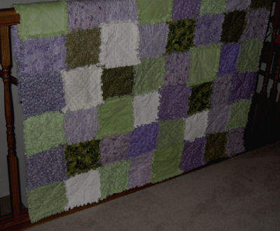 Try making a shabby chic cottage style raggedy quilt with lilac and green fabrics.