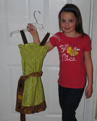 Eight year old Lilly makes a dress for her fashion show collection she will be showing in the fall.