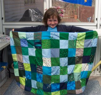 Lucy makes her 1st quilt using pretty green and blue fabrics.