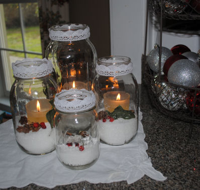 antique mason jars filled with epson salt a votive candle holly berries