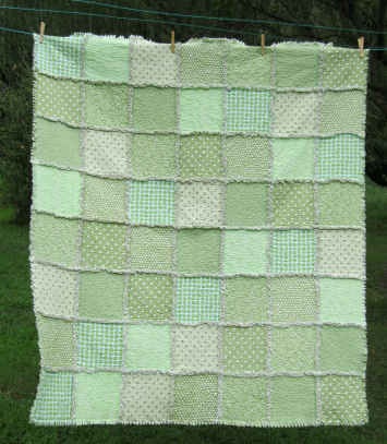 Here's a mint green handmade raggedy quilt.