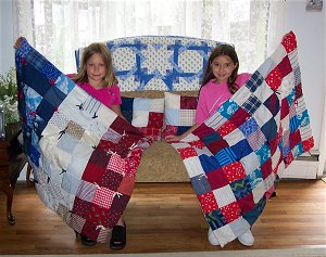 Friends make a patriotic quilt using the same squares but in a different pattern.