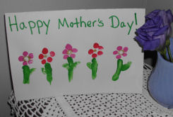 A handmade card for Mother's day, child's fingerprints make flowers for a card for mom.