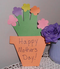 A handmade Mother's day card, a handprint flowers in a cup card for mom.