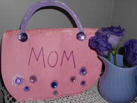 A handmade card for Mother's day, a handmade purse card for mom.