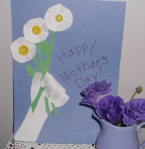 A handmade card for mom for Mother's day, a child's handprint holding a bouquet of flowers card for mom.