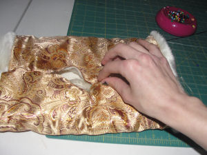 Hand sew the opening of your muff closed.