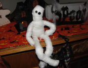 Using a doll that is ready made, cheese cloth, and 2 buttons or snaps for eyes, you can make this too cute bendable mummy doll in less than 5 minutes!
