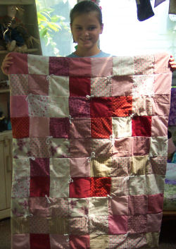 "A pink and red ""My 1st Quilt."""