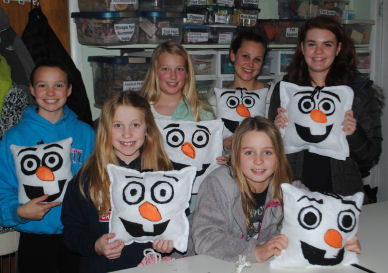 A frozen party and learn to sew and make an Olaf pillow.