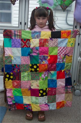 Olivia make her very 1st quilt using our easy to follow directions.