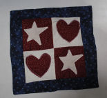How to make a patriotic Americana heart and star mini quilt.