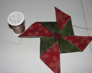 Free fabric pinwheel Christmas tree ornament for sewing.