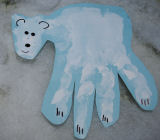 Polar bear hand print arts and crafts project for kids.