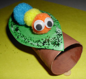 How to make pompom critter bug resting on a log toilet for Bugs arts and crafts