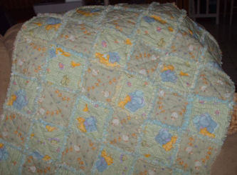 Debbie from NC makes this adorable baby rag quilt from duck fabric!