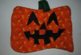 Here's a cute Jack-O-Lantern Pumpkin Face Quilted Wall Hanging that is easy to sew and perfect for our front door to invite guests in at Halloween time.