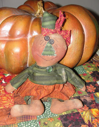 Handmade Prim Pumpkin Girl doll a DIY Halloween craft from Love to sew studio.
