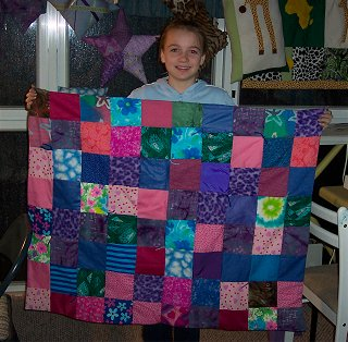 I love these colors on this handmade quilt that Katie made!