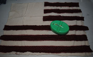 Simply sew on red strips of fabric to make this cute American flag raggedy pillow.