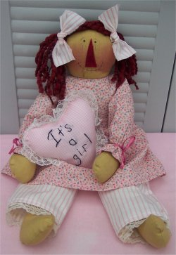Here's a sweet doll you can make for someone who just had a baby girl.