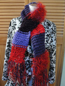 A knitted scarf for the red hats group.