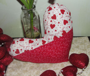 Easy to sew Valentine's day craft project; a red and white heart shapped pillow.