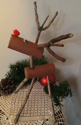 Kids Christmas craft project, reindeer made from painted toilet paper rolls and sticks from tree branches.