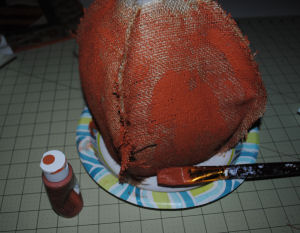 Paint the burlap pumpkin craft.