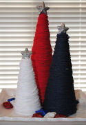 See how to make patriotic yarn cones into a center piece display for your 4th of July decorating.