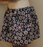 Learn to sew this cute little girls thick elastic waistband skirt.