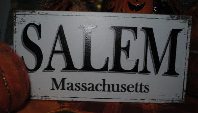 A wooden sign saying Salem Massachusetts to go with all my Halloween decorations.
