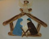 Popsicle stick nativity arts and crafts project for kids to make as a Christmas bible or church lesson.