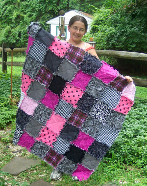 Samantha makes a beautiful pink black and white raggedy quilt
