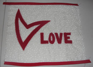 How to make a quilt art piece with a heart and LOVE for Valentine's day.