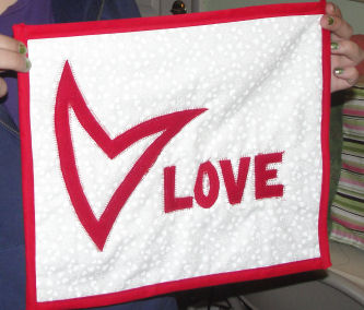 How to make a quilt art with a heart for Valentine's day.