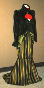 Front view of the female vampire costume with a pinstripe full length mermaid skirt.