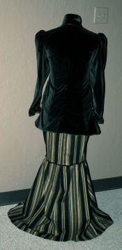 Back view of the female vampire costume with a pinstripe full length mermaid skirt.
