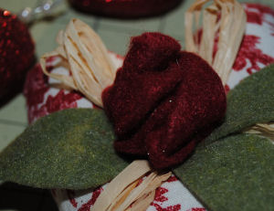 Learn how to make a beautiful Victorian heart with a felt rose for Valentine's day.