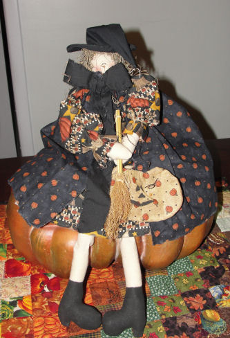 Hand made fabric Halloween witch doll with painted boot legs.