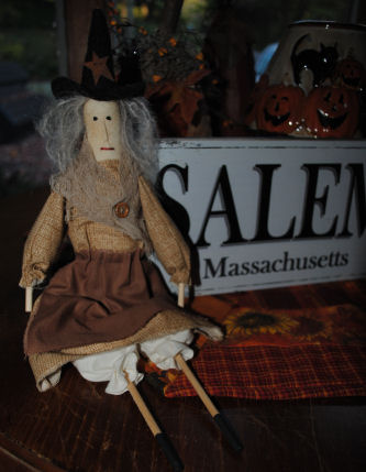 A cute handmade witch doll I bought in Salem Massachusetts. Sticks were used for the arms and legs of the witch.