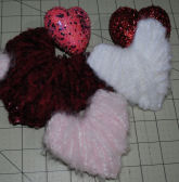 Here are easy to make yarn hearts to hang or put in a bowl using cardstock and yarn.